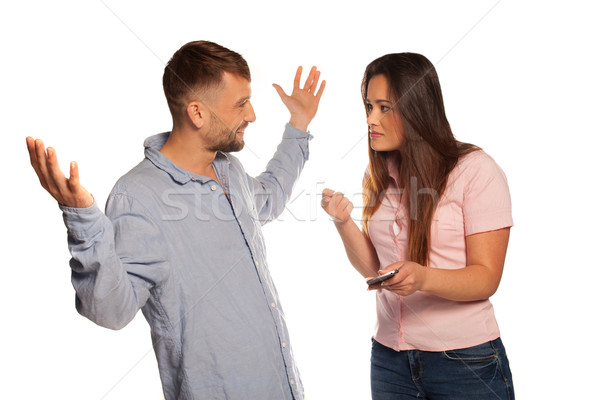 Young couple having an argument with defensive man Stock photo © stryjek