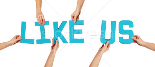 Female hands holding letters LIKE US Stock photo © stryjek