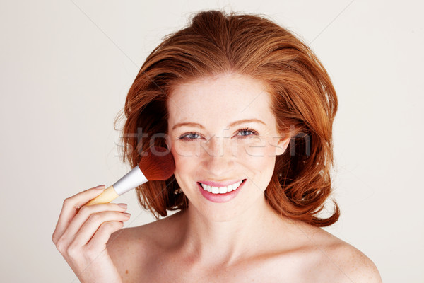 Smiling Woman Applying Blusher Stock photo © stryjek
