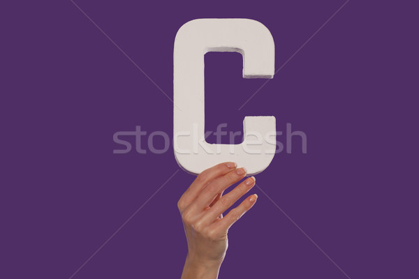 Female hand holding up the letter C from the bottom Stock photo © stryjek