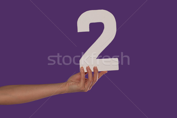 Female hand holding up the number 2 from the left Stock photo © stryjek