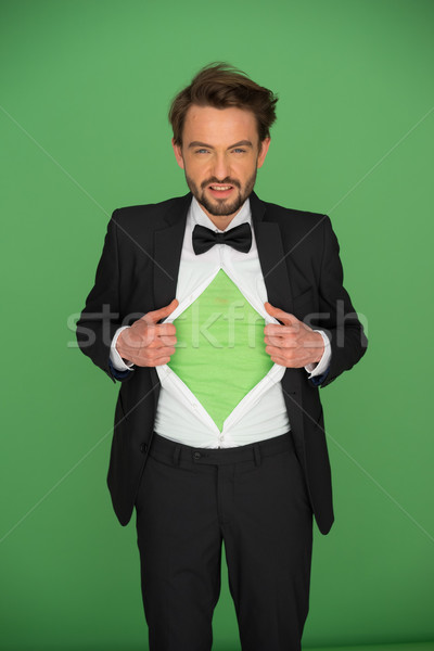 Man in a suit and bow tie revealing his chest Stock photo © stryjek