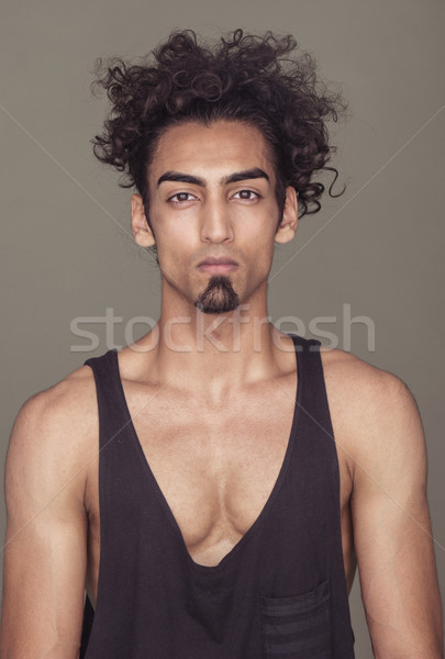 Gorgeous Fit Guy with Curly Hair Against Gray Stock photo © stryjek