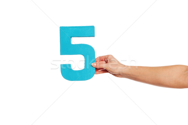 Stock photo: hand holding up the number five from the right