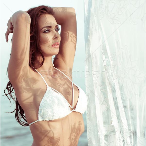 Woman in White Bikini Standing Near Lace Curtain Stock photo © stryjek