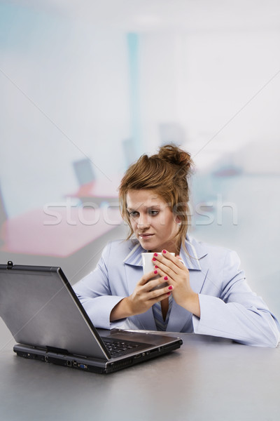 Stock photo: Woman with laptop drinking coffee