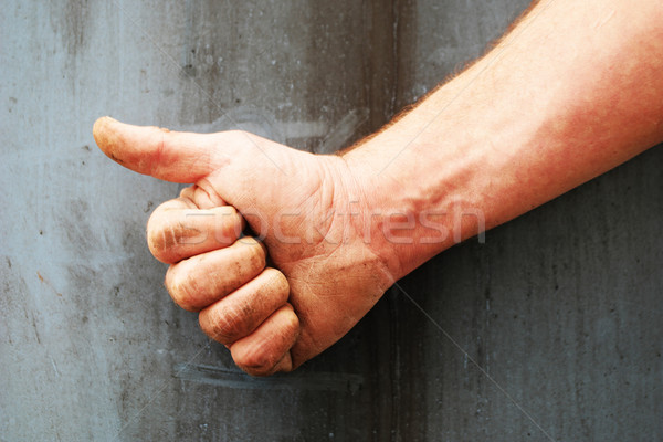Male right hand showing thumbs up Stock photo © stryjek