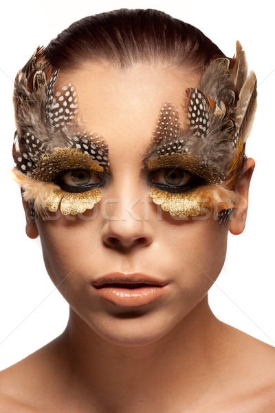Woman wearing creative feather make-up Stock photo © stryjek