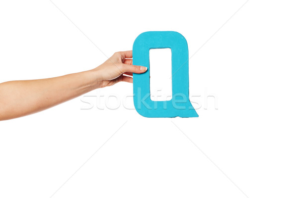 hand holding up the letter Q from the left Stock photo © stryjek