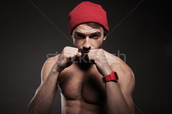 Dopasować młody człowiek agresywny stanowią broni Zdjęcia stock © stryjek