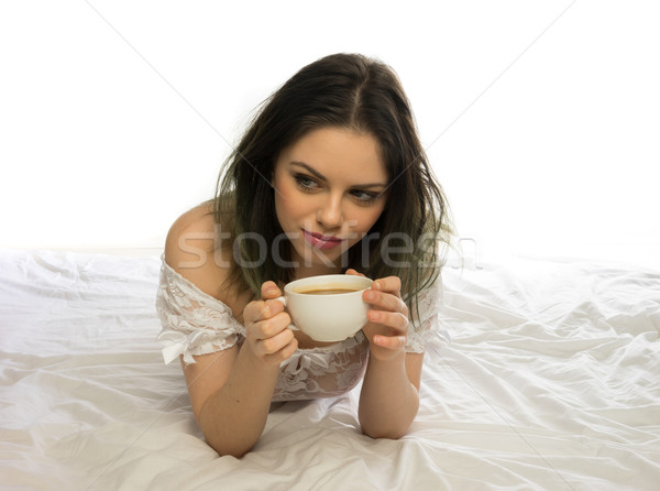 Stock photo: Young woman daydreaming while enjoying coffee