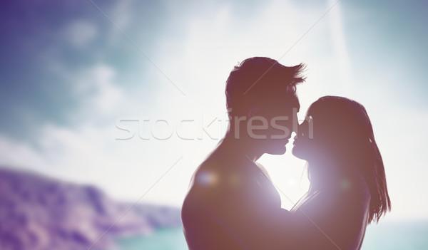 Loving couple backlit by a bright sun Stock photo © stryjek