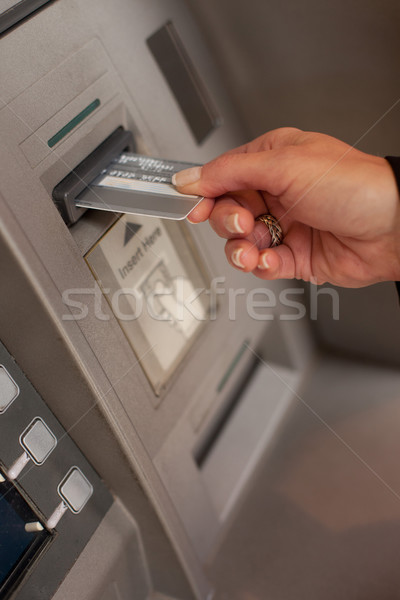 Female hand inserting ATM card Stock photo © stryjek