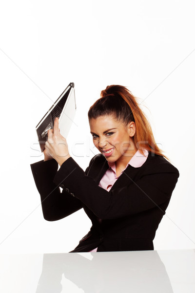 Angry businesswoman about to smash her laptop Stock photo © stryjek