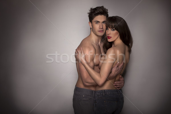 Apasionado sexy top-less Pareja oscuro estudio Foto stock © stryjek