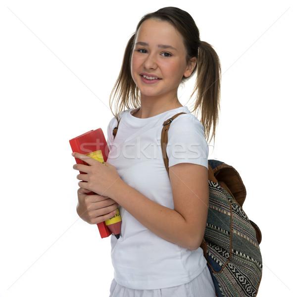 Mosolyog boldog vonzó fiatal iskolás lány hordoz Stock fotó © stryjek