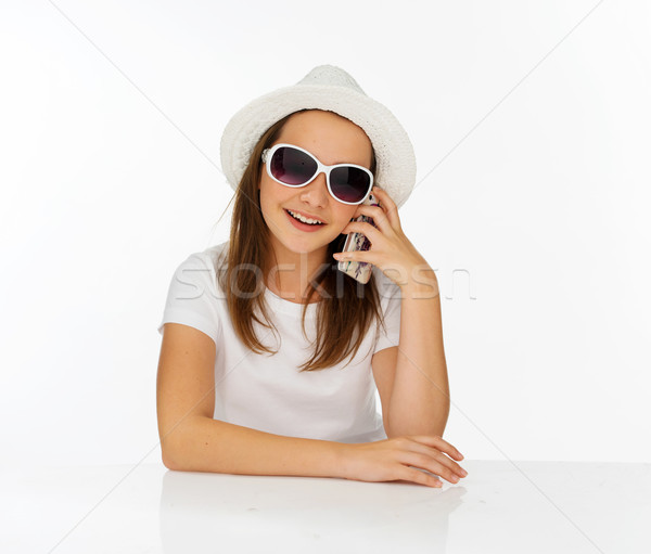 Trendy young girl chatting on her mobile Stock photo © stryjek