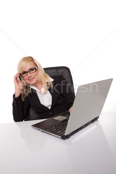 Businesswoman in glasses working Stock photo © stryjek