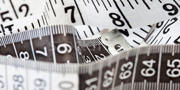 Measuring tape, symbol of tailoring and diets Stock photo © stryjek