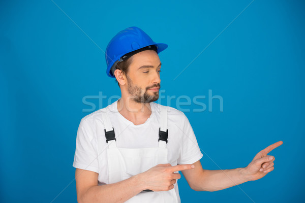 Upbeat workman pointing to the right Stock photo © stryjek