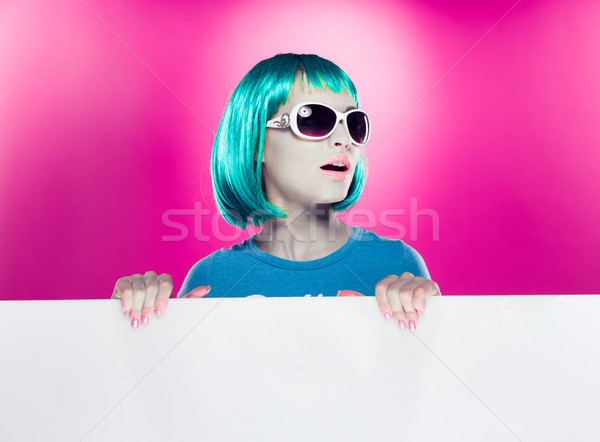 Trendy modern woman holding a blank sign Stock photo © stryjek