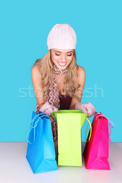 Excited Woman Looking In Shopping Bag Stock photo © stryjek