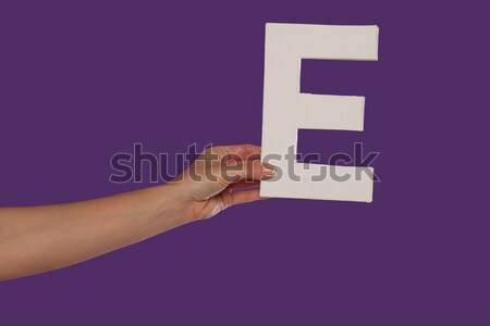 Female hand holding up the letter L from the left Stock photo © stryjek