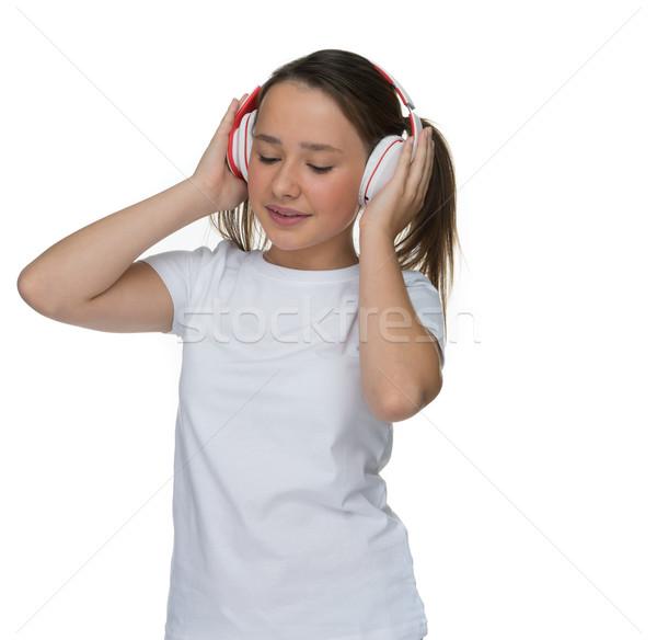 Atractivo nina música auriculares pie Foto stock © stryjek