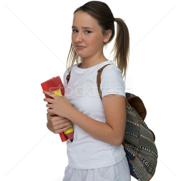 Young schoolgirl grimacing as she leaves for class Stock photo © stryjek
