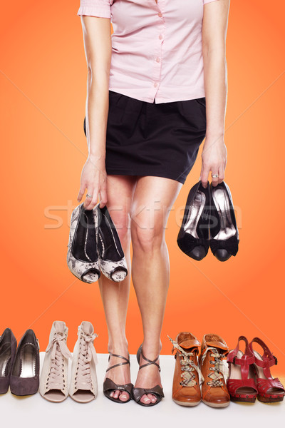 Woman with a passion for shoes Stock photo © stryjek