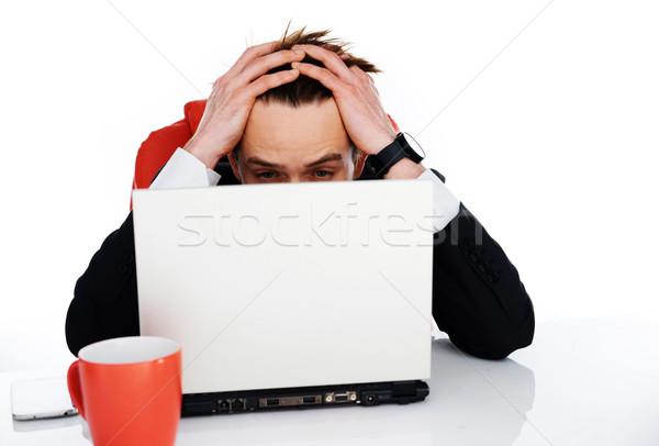 Worried businessman holding his head in his hands Stock photo © stryjek