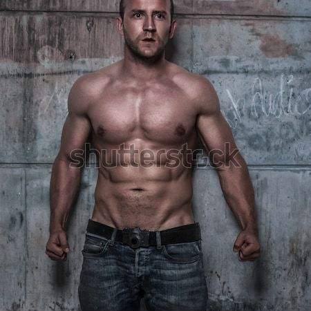 fitness male model in old garage Stock photo © stryjek