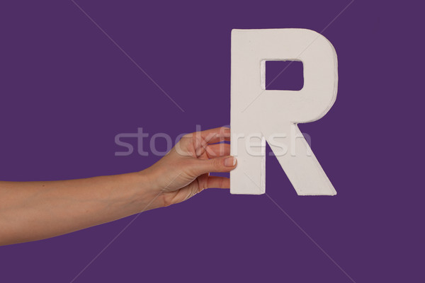 Female hand holding up the letter R from the left Stock photo © stryjek