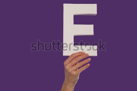 Female hand holding up the letter F from the right Stock photo © stryjek