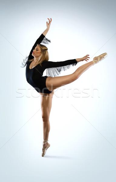 Beautiful ballet dancer doing an arabesque Stock photo © stryjek