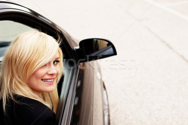 Pretty blonde automobile passenger Stock photo © stryjek