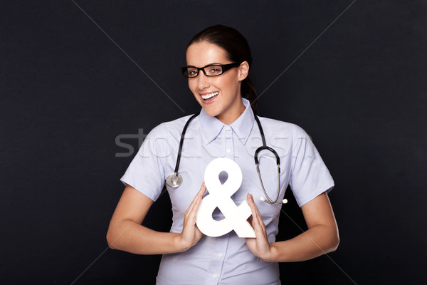 Doctor holding an ampersand symbol Stock photo © stryjek
