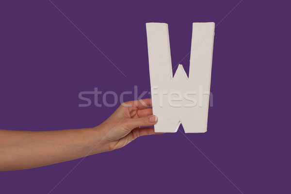 Female hand holding up the letter W from the left Stock photo © stryjek