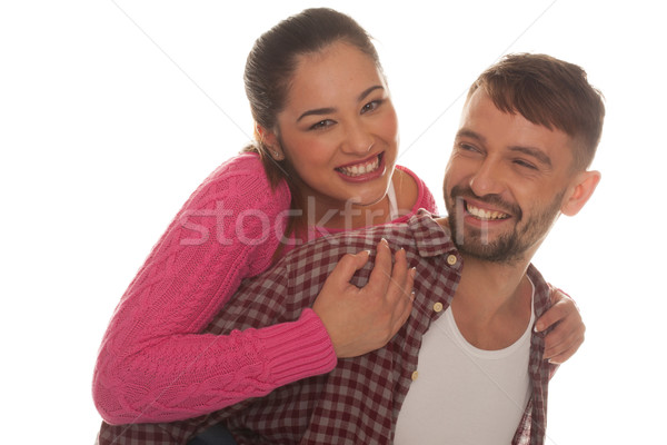 Happy woman riding piggyback on the boyfriend Stock photo © stryjek