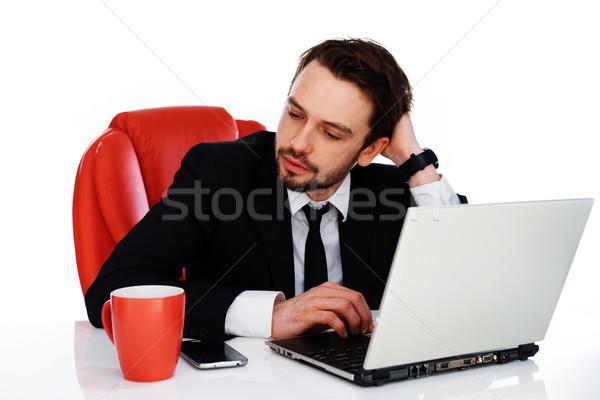 Hardworking businessman pausing to think Stock photo © stryjek