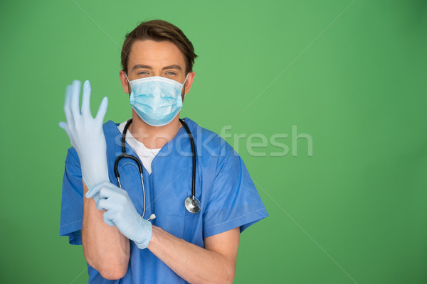 Arts chirurgisch handschoenen jonge mannelijke arts Stockfoto © stryjek