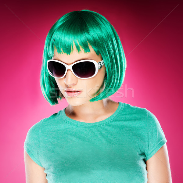 Stock photo: Trendy beautiful young woman in sunglasses