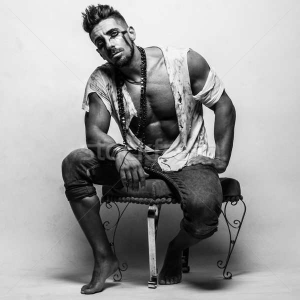Muscular Man in Ragged Clothes Sitting on a Chair Stock photo © stryjek
