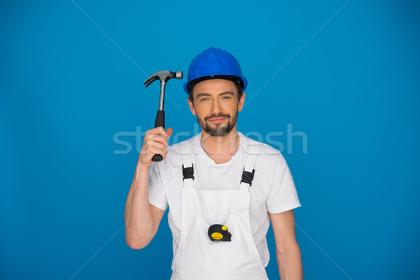 Smiling workman holding up a hammer Stock photo © stryjek