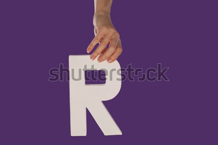 Female hand holding up the letter B from top Stock photo © stryjek