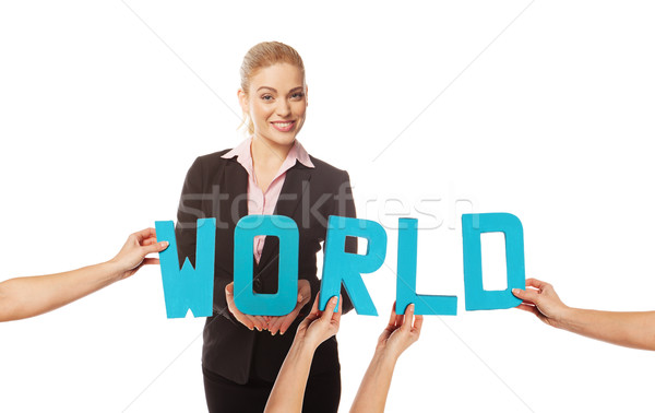 Smiling woman with the word WORLD Stock photo © stryjek