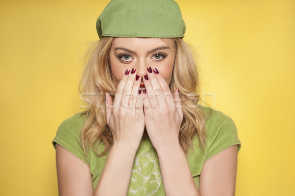 Beautiful woman showing off her manicured nails Stock photo © stryjek