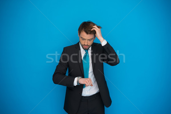 businessman in rush looking at his watch , running late Stock photo © stryjek