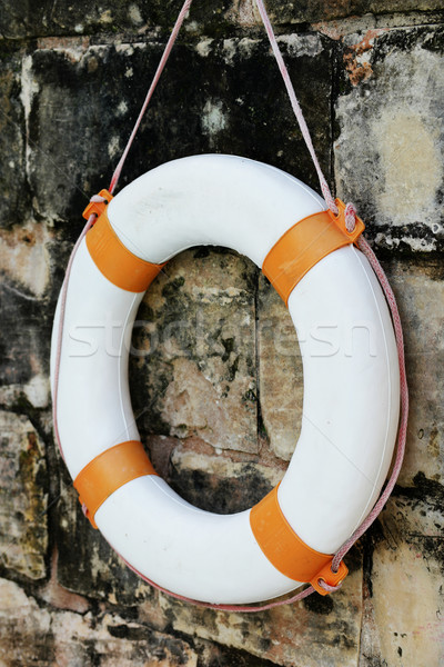 Close up Lifebuoy Hanging on Old Wall Stock photo © stryjek
