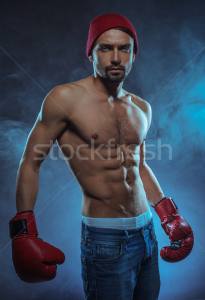 Young athletic boxer in a smoky background Stock photo © stryjek